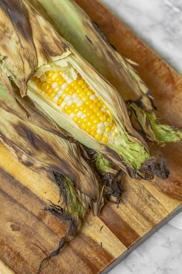 How to Grill Corn in the Husk on Cutting Board