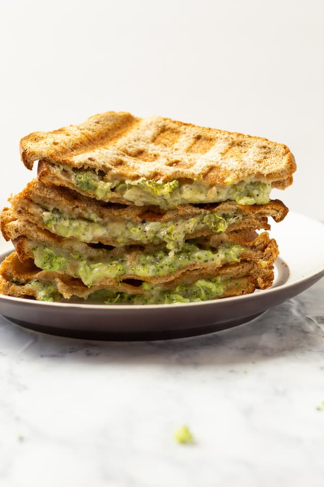 Broccoli Cheddar Waffle Grilled Cheese Stacked on Plate