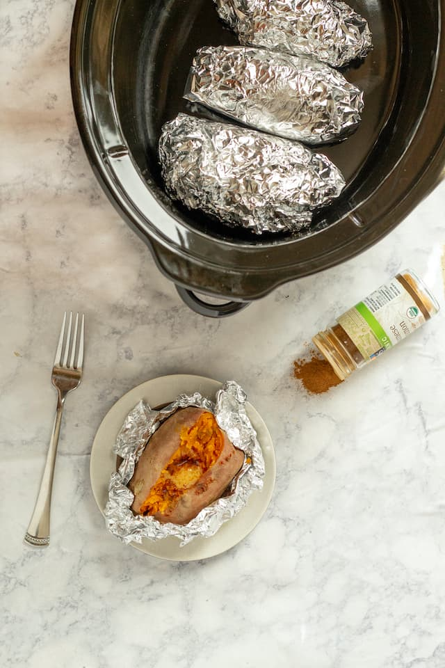 Slow Cooker Sweet Potatoes on Plate with Fork